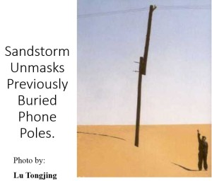P{icture of Sand blown away exposing an extension on power pole
